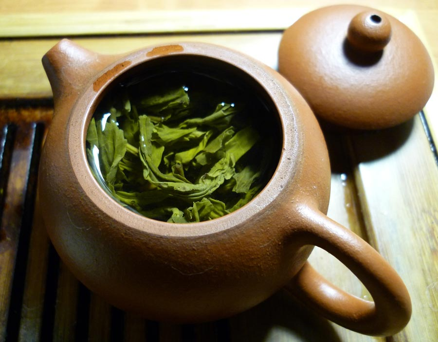 Green tea is being made in the teacup