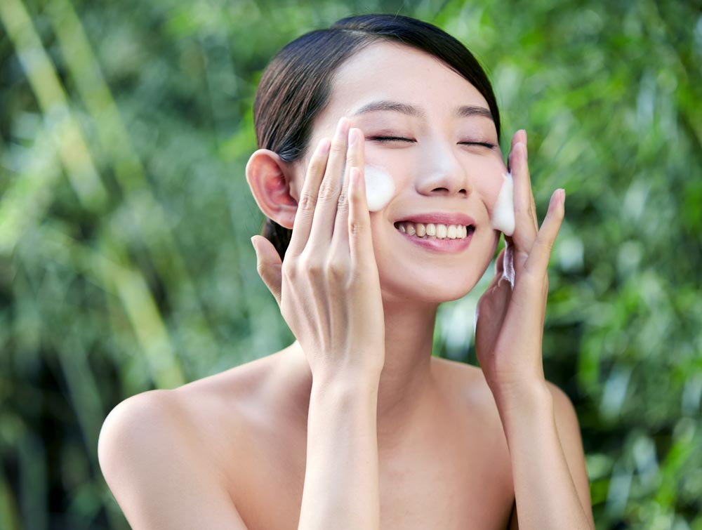 Face Washing Profile. A beauty rubbed the foam of the facial cleanser to wash her face.