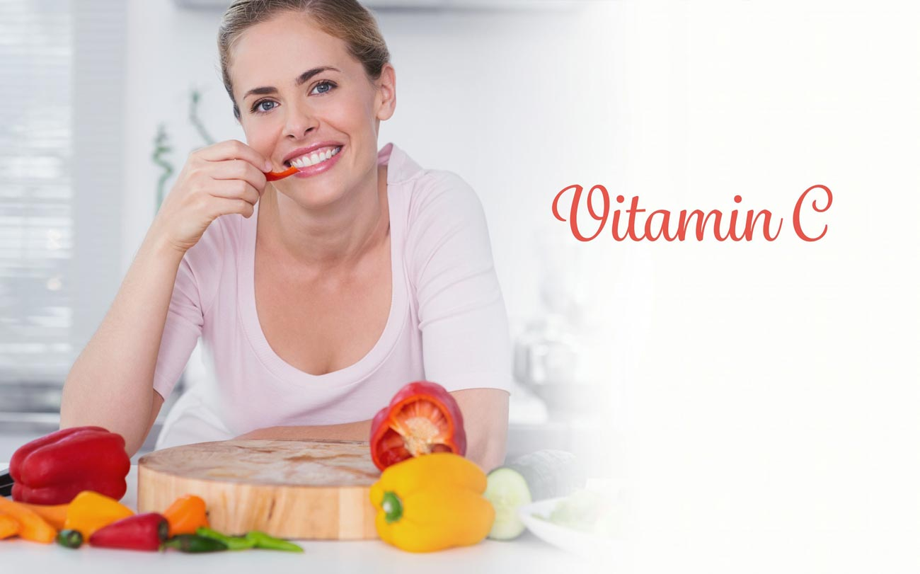 A woman is eating fruits rich in vitamin C. Such as tomatoes, lemons, oranges.